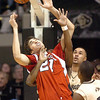 Jorge Brian Diaz of Nebraska is fouled from behind by Dwight Thorne (hidden) of Colorado. Marcus Relphorde of CU is on the right.<br /> Cliff Grassmick / January 27, 2010