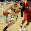 Nate Tomlinson of CU dribbles past Myles Holley of Nebraska.<br /> Cliff Grassmick / January 27, 2010