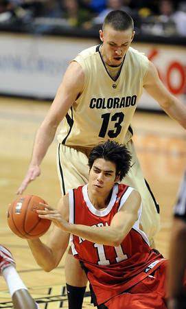Christian Standhardinger of Nebraska gets the ball away while Shane Harris-Tunks of CU defends.<br /> Cliff Grassmick / January 27, 2010