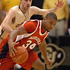 Lance Jeter of NU dribbles around Nate Tomlinson of Colorado.<br /> Cliff Grassmick / January 27, 2010