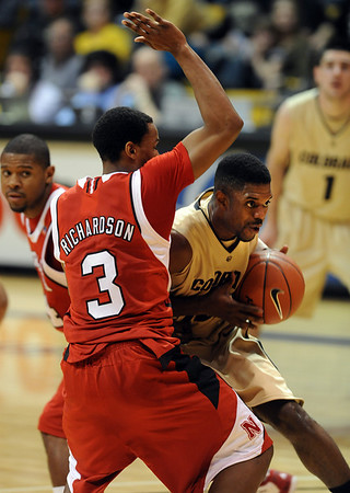 Dwight Thorne of CU collides with Brandon Jefferson of Nebraska.<br /> Cliff Grassmick / January 27, 2010