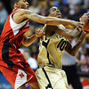 Alec Burks of Colorado drives on Eshaunte Jones of Nebraska and is fouled late in the game.<br /> Cliff Grassmick / January 27, 2010