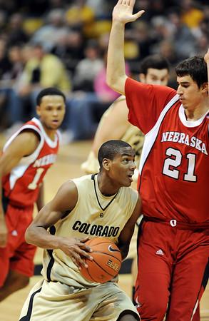 Alec Burks of CU drives to the basket on Jorge Diaz of Nebraska.<br /> Cliff Grassmick / January 27, 2010
