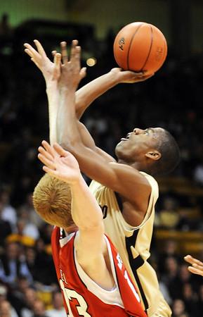 Alec Burks of Colorado puts up a shot on Brandon Ubel of Nebraska.<br /> Cliff Grassmick / January 27, 2010
