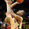 Alec Burks of Colorado puts up a shot on Brandon Ubel of Nebraska.<br /> Cliff Grassmick / January 27, 2010