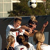 Carly Peetz of NU and Amy Barczuk of CU go high to hit the ball.<br /> Cliff Grassmick / September 25, 2009