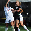 Shaye Marshall (7) of CU and Molly Thomas of Nebraska go up on a header on Friday.<br /> Cliff Grassmick / September 25, 2009