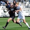 Nikki Marshal (17) of CU out muscles Carly Peetz of Nebraska while charging the goal.<br /> Cliff Grassmick / September 25, 2009