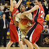 Brittany Spears, center, of Colorado, gets trapped between Cory Montgomery, left, and Kelsey Griffin of Nebraska during the first half of the January 30, 2010 game in Boulder.<br /> Cliff Grassmick / January 30, 2010