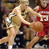 Alyssa Fressle of CU dribbles around Kala Kuhlman of Nebraska.<br /> Cliff Grassmick / January 30, 2010