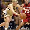 Alyssa Fressle of CU dribbles around Kala Kuhlman of Nebraska.<br /> Cliff Grassmick / January 30, 2010