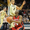 Dominique Kelley of Nebraska tries to shoot over Bianca Smith of Colorado during the first half of the January 30, 2010 game in Boulder.<br /> Cliff Grassmick / January 30, 2010