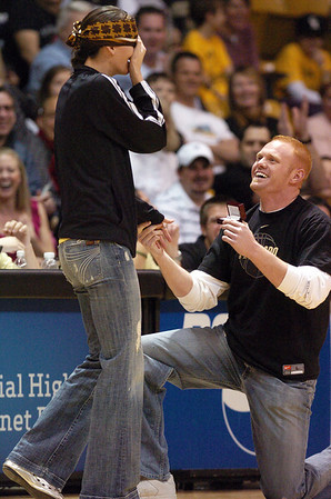 Caleb Ring asks former CU  basketball player Jackie McFarland for her hand in marriage during the CU-Nebraska women's game on Saturday. Jackie was blindfolded and thought she was trying to win pizza for a year when Caleb grabbed her.<br /> Cliff Grassmick / January 30, 2010