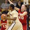 Cory Montgomery of Nebraska, pressures Courtney Dunn of Colorado on Saturday.<br /> Cliff Grassmick / January 30, 2010