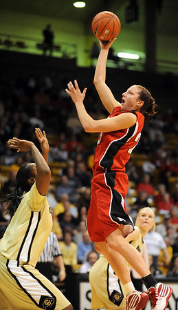 Kelsey Griffin of Nebraska shoots over Courtney Dunn of Colorado.<br /> Cliff Grassmick / January 30, 2010