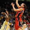Kelsey Griffin of Nebraska shoots over Courtney Dunn of Colorado.<br /> Cliff Grassmick / January 30, 2010