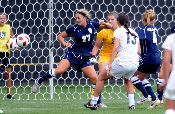 "Kate Russell (13) of Colorado, scores past Ambree Bellin of UNC.<br /> For more photos of the game, go to  <a href=""http://www.dailycamera.com"">http://www.dailycamera.com</a><br /> Cliff Grassmick / August 21, 2011"