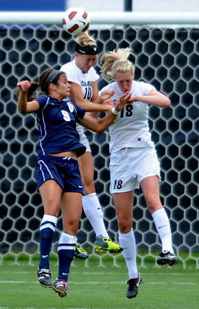 "Amy Barczuk (10) and Lizzy Herzl, both of CU, protect the goal from JJ Wykstra of UNC.<br /> For more photos of the game, go to  <a href=""http://www.dailycamera.com"">http://www.dailycamera.com</a><br /> Cliff Grassmick / August 21, 2011"