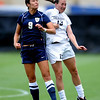 """JJ Wykstra (9) of UNC, and Kate Russell of Colorado go up on a header.<br /> For more photos of the game, go to  <a href=""""http://www.dailycamera.com"""">http://www.dailycamera.com</a><br /> Cliff Grassmick / August 21, 2011"""