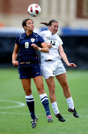 "JJ Wykstra (9) of UNC, and Kate Russell of Colorado go up on a header.<br /> For more photos of the game, go to  <a href=""http://www.dailycamera.com"">http://www.dailycamera.com</a><br /> Cliff Grassmick / August 21, 2011"