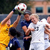 "UNC Keeper, Kirstin  Salminen, left, knocks the ball away from Anne Stuller  and Amy Barczuk, both of Colorado. JJ Wykstra of UNC is also defending.<br /> For more photos of the game, go to  <a href=""http://www.dailycamera.com"">http://www.dailycamera.com</a><br /> Cliff Grassmick / August 21, 2011"