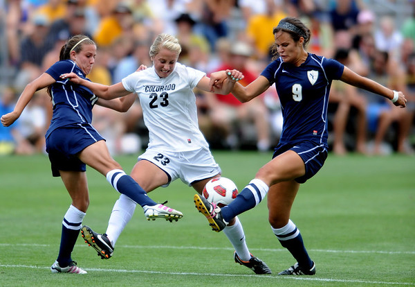 "Anne Stuller (23) of CU is doubled by Eryn Daniel, left, and JJ Wykstra of UNC.<br /> For more photos of the game, go to  <a href=""http://www.dailycamera.com"">http://www.dailycamera.com</a><br /> Cliff Grassmick / August 21, 2011"