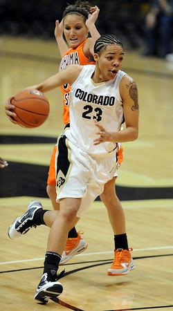 Chucky Jeffery of Colorado gets past Lakyn Garrison of OSU.<br /> Cliff Grassmick / January 24, 2010