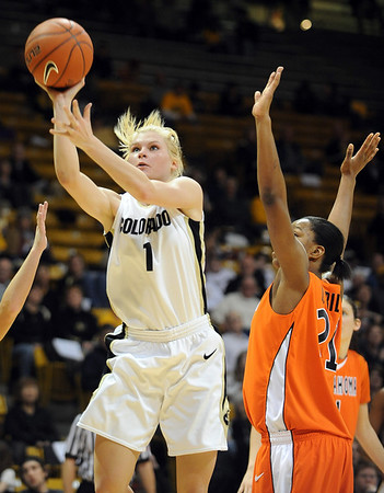 Alyssa Fressle of CU shoots past LaSharra Riley of OSU.<br /> Cliff Grassmick / January 24, 2010
