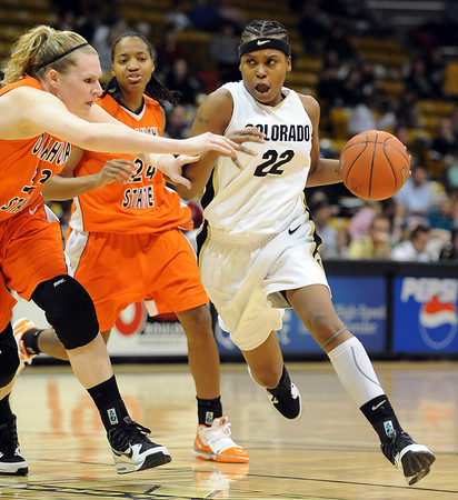 "Brittany Spears of CU drives to the basket against Megan Byford of Oklahoma State.For more photos, go to the photo galleries at  <a href=""http://www.dailycamera.com"">http://www.dailycamera.com</a>.<br /> Cliff Grassmick / January 24, 2010"
