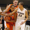 Precious Robinson, left, of OSU, runs into Chucky Jeffery of CU on Sunday.<br /> Cliff Grassmick / January 24, 2010