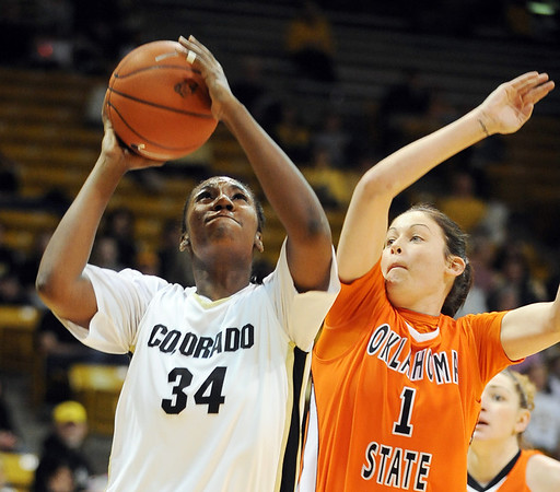 "Courtney Dunn, left, of Colorado shoots over Tegan Cunningham of Oklahoma State during the first half of the January 24, 2010 game in Boulder. For more photos, go to the photo galleries at  <a href=""http://www.dailycamera.com"">http://www.dailycamera.com</a>.<br /> Cliff Grassmick / January 24, 2010"