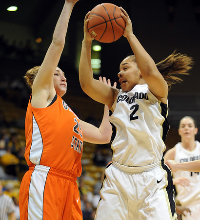 Bianca Smith of Colorado dives to the basket against Lindsay Keller of OSU.<br /> Cliff Grassmick / January 24, 2010