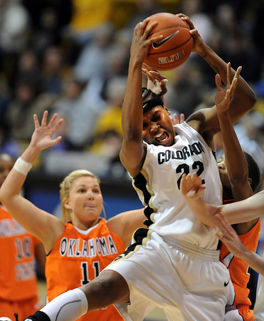 "Brittany Spears of CU crashes the boards against Oklahoma State on Sunday.<br /> For more photos, go to the photo galleries at  <a href=""http://www.dailycamera.com"">http://www.dailycamera.com</a>.<br /> Cliff Grassmick / January 24, 2010"