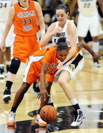 "Andrea Riley, left, of Oklahoma State, tries to get past Meagan Malcolm-Peck of Colorado during the second half have of the January 24, 2010 game in Boulder.For more photos, go to the photo galleries at  <a href=""http://www.dailycamera.com"">http://www.dailycamera.com</a>.<br /> Cliff Grassmick / January 24, 2010"