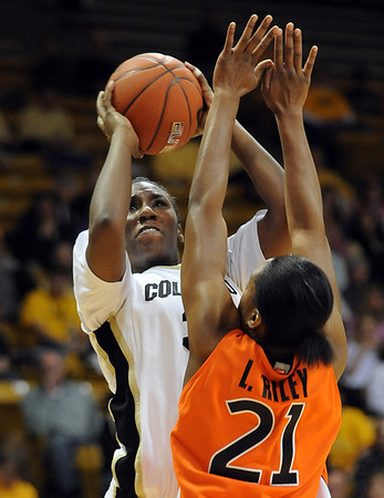 "Coutney Dunn of Colorado puts up a shot on LaSharra Riley of Oklahoma State on Sunday.<br /> For more photos, go to the photo galleries at  <a href=""http://www.dailycamera.com"">http://www.dailycamera.com</a>.<br /> Cliff Grassmick / January 24, 2010"