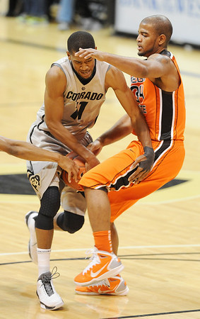 "Cory Higgins of CU runs into Lathen Wallace of Oregon State.<br /> For more photos of the game, go to  <a href=""http://www.dailycamera.com"">http://www.dailycamera.com</a>.<br /> Cliff Grassmick / December 4, 2010"