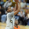 "Alec Burks puts up a shot against Oregon State.<br /> For more photos of the game, go to  <a href=""http://www.dailycamera.com"">http://www.dailycamera.com</a>.<br /> Cliff Grassmick / December 4, 2010"