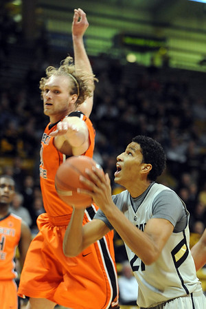 Andre Roberson, right, of Colorado, ducks under the defense of Daniel Deane of Oregon State during the first half of the December 4, 2010 game in Boulder.<br /> Cliff Grassmick / December 4, 2010