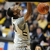 "Alec Burks finishes off a dunk against Oregon State.<br /> For more photos of the game, go to  <a href=""http://www.dailycamera.com"">http://www.dailycamera.com</a>.<br /> Cliff Grassmick / December 4, 2010"