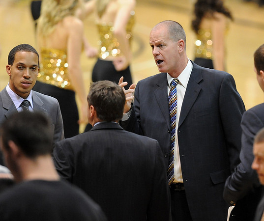 """Colorado coach, Tad Boyle, talks to his staff in the Oregon State game.<br /> For more photos of the game, go to  <a href=""""http://www.dailycamera.com"""">http://www.dailycamera.com</a>.<br /> Cliff Grassmick / December 4, 2010"""