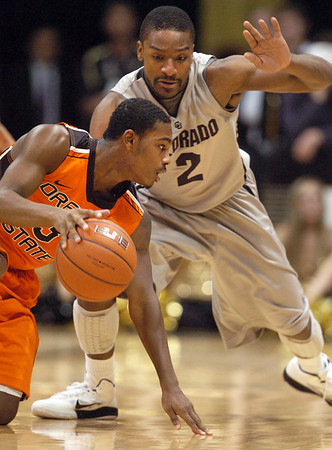 Ahmad Starks of Oregon State tries to get around Shannon Sharpe of Colorado during the first half of the December 4, 2010 game in Boulder.<br /> Cliff Grassmick / December 4, 2010