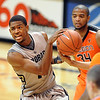 "Cory Higgins of Colorado tries to control the ball against Oregon State.<br /> For more photos of the game, go to  <a href=""http://www.dailycamera.com"">http://www.dailycamera.com</a>.<br /> Cliff Grassmick / December 4, 2010"