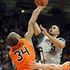 Marcus Relphorde of Colorado shoots over Lathen  Wallace of Oregon State during the first half of the December 4, 2010 game on Boulder.<br /> Cliff Grassmick / December 4, 2010