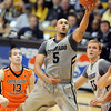 """Marcus Relphorde of Colorado drives to the basket past Rhys Murphy of Oregon State in the second half of the December 4, 2010 game in Boulder.<br /> For more photos of the game, go to  <a href=""""http://www.dailycamera.com"""">http://www.dailycamera.com</a>.<br /> Cliff Grassmick / December 4, 2010"""