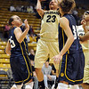 "Chucky Jeffery  of CU puts up a shot on Regis in the big win.<br /> For more photos of the game, go to  <a href=""http://www.dailycamera.com"">http://www.dailycamera.com</a><br /> Cliff Grassmick / November 12, 2010"