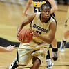 "Brittany Wilson of CU drives against Regis in the win Friday night.<br /> For more photos of the game, go to  <a href=""http://www.dailycamera.com"">http://www.dailycamera.com</a><br /> Cliff Grassmick / November 12, 2010"