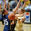 "Julie Seabrook of CU, passes around Meagan Nickell of Regis.<br /> For more photos of the game, go to  <a href=""http://www.dailycamera.com"">http://www.dailycamera.com</a><br /> Cliff Grassmick / November 12, 2010"