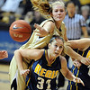 "Julie Seabrook, top, of CU, knocks the ball away from Erin O'Toole of Regis during the CU win.<br /> For more photos of the game, go to  <a href=""http://www.dailycamera.com"">http://www.dailycamera.com</a><br /> Cliff Grassmick / November 12, 2010"