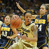 "Chucky Jeffery of CU looks to score on Lauren Luebbe of Regis in the 76-38 win for CU.<br /> For more photos of the game, go to  <a href=""http://www.dailycamera.com"">http://www.dailycamera.com</a><br /> Cliff Grassmick / November 12, 2010<br /> One of Best Shots"