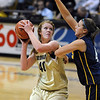 "Rachel Hargis looks to score over Brandi Collins of Regis.<br /> For more photos of the game, go to  <a href=""http://www.dailycamera.com"">http://www.dailycamera.com</a><br /> Cliff Grassmick / November 12, 2010"